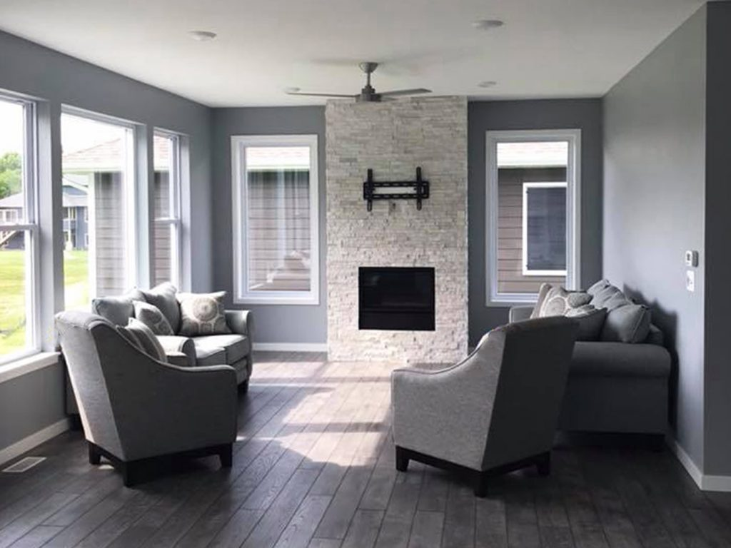 SGA Construction new home interior with fire place and grey furniture